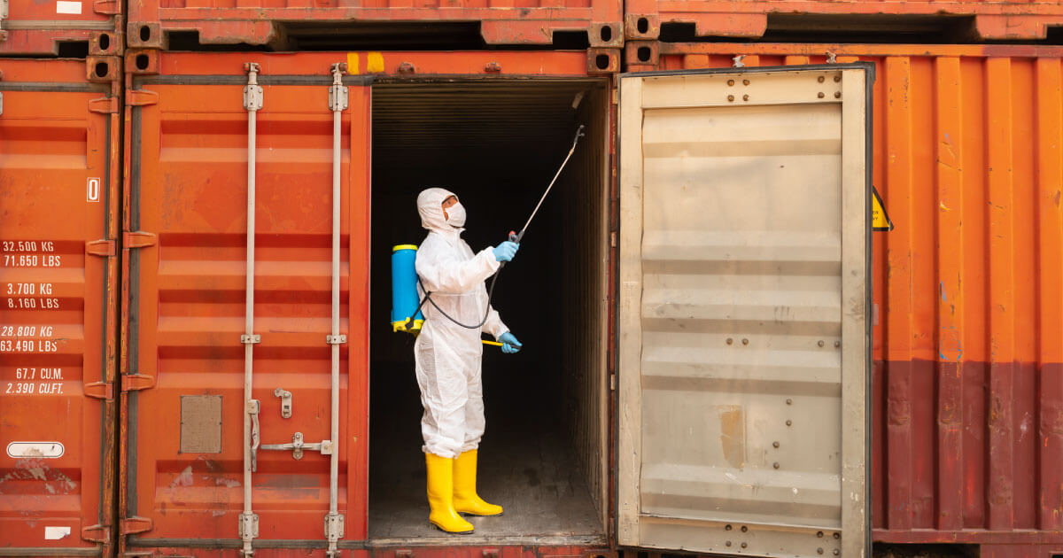 Inspector looking at cargo container before packing with electronic components; are you concerned about mitigating supply chain risk? Take a look at Sourcengine's e-commerce marketplace for help.