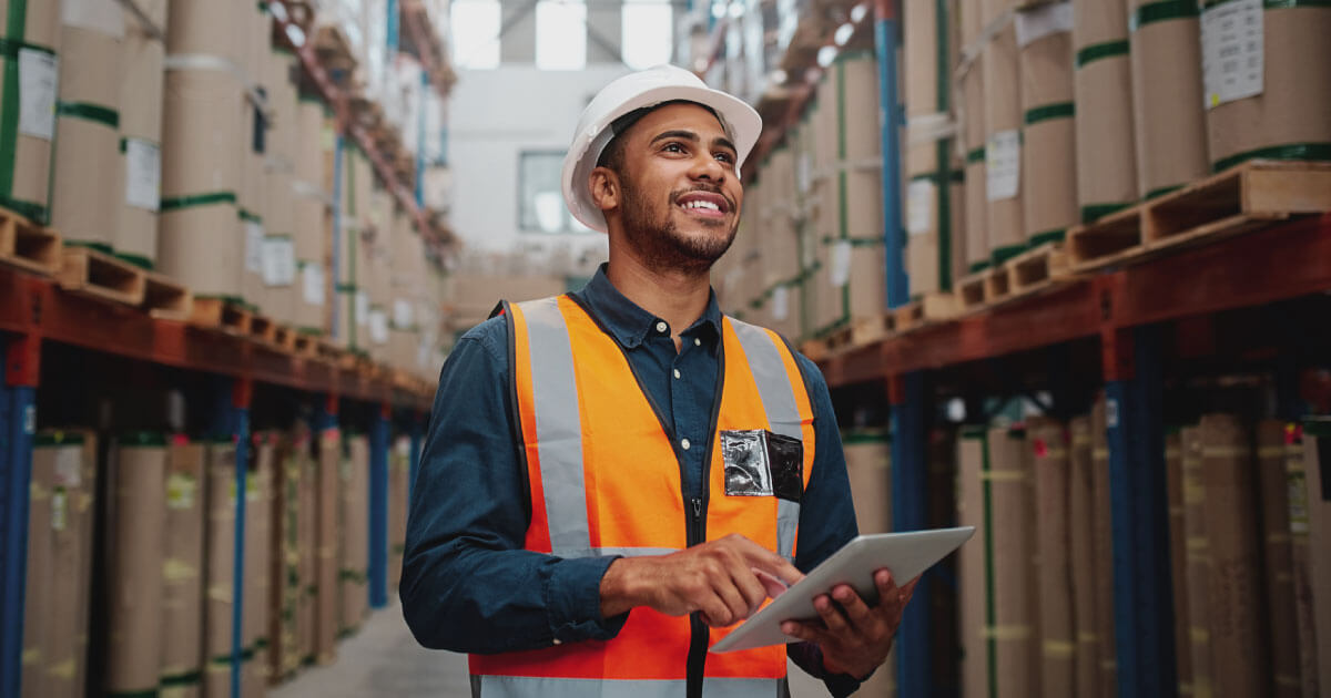 Supply chain professional in the electronic components industry checking a list of parts against stock on hand. Build supply chain resiliency today with Sourcengine.