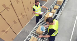 Two supply chain specialists using tablet computers while checking components. See how your supply chain can be made more agile with technology platforms like Sourcengine.