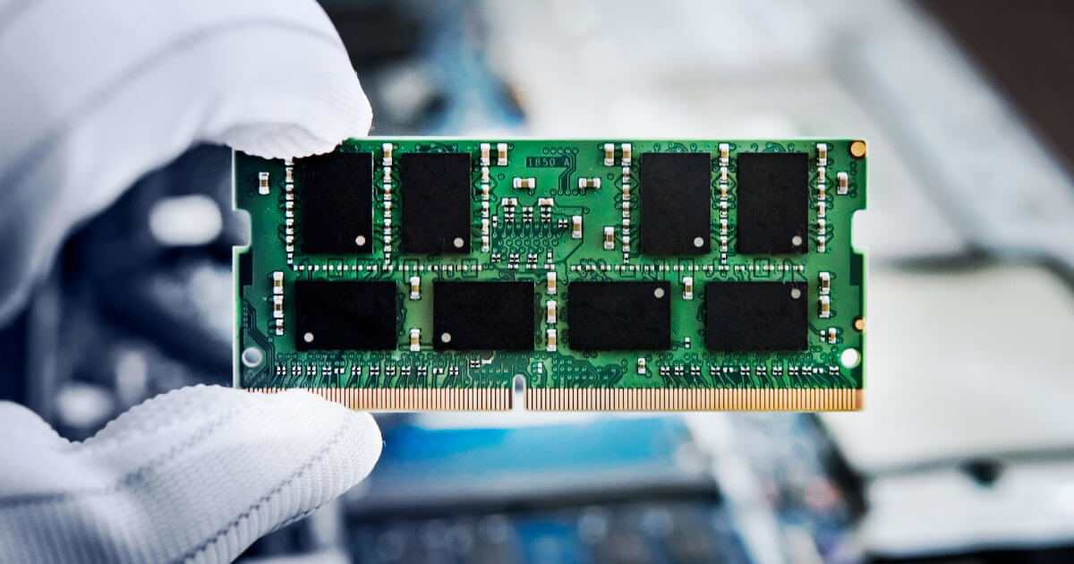 Memory chip in hands of engineer. For more on the latest DRAM and NAND chips, see data sheets, availabilities and pricing at Sourcengine.