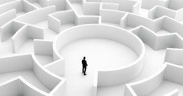 Individual stands at the center of a labyrinth; navigating the complexities of the component supply chain will be like a maze in 2021; but Sourcengine's e-commerce marketplace can help.