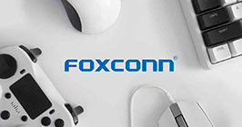 Foxconn logo set against game controllers and more devices; for latest information on Foxconn see Sourcengine.