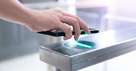 Individual using a smart phone to gain access via a touchless entry point system; for the latest electronic components industry trends in 2021, see Sourcengine.