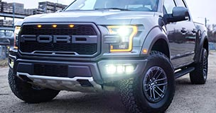 Ford truck on display; due to recent shortages in the component industry, Ford has been forced to temporarily halt production of its popular F-150. If you're dealing with shortages, check out Sourcengine where you can buy franchise-direct and from distributors.