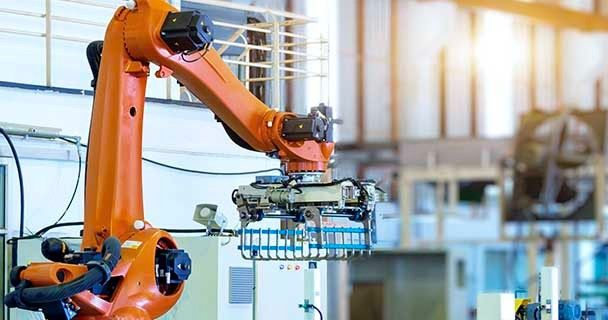 An industrial gripper robot in an automated factory; Sourcengine provides a three-year warranty for all electronic components purchase through its marketplace.