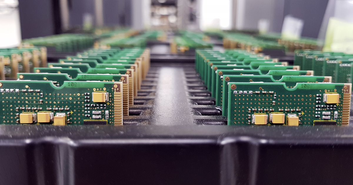 Multiple rows of assembled green printed circuit boards. | Sourcengine