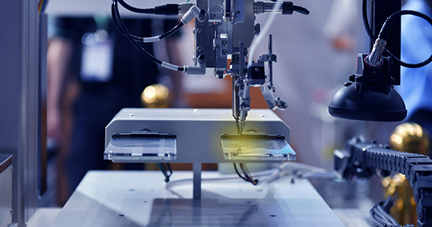 A factory robot soldering a PCB inside a microchip manufacturing facility | Sourcengine