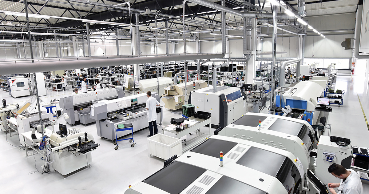 An overhead view of a fully staffed electronic components smart factory. | Sourcengine