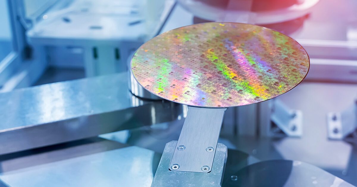 A silicon wafer sits on a piece of production equipment during the chipmaking process.