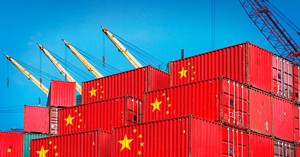 Two stack of shipping containers stamped with the details of the Chinese flags.